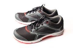 Nouveaux noir et rouge sans marque de couleur de chaussure de course Photos libres de droits