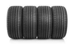 Nouveaux pneus de voiture d'isolement sur le fond blanc Photos libres de droits