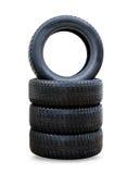 Nouveaux pneus noirs d'hiver pour la voiture Photo stock