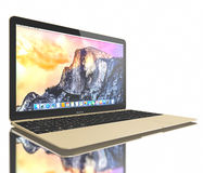 Nouvel air de MacBook d'or Images libres de droits