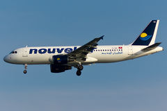 NouvelAir Airbus A320 Plane. In the sky Stock Images