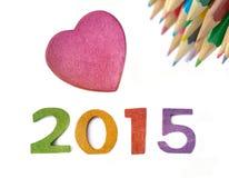 Nouvelle année avec les crayons et le coeur Image stock