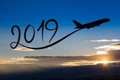 Nouvelle année 2019 en pilotant l'avion sur l'air au lever de soleil Photographie stock libre de droits