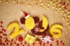 Nouvelle année 2016 Noël Singe drôle avec la banane Image libre de droits