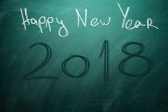 Nouvelle année 2018 sur le conseil vert tableau Photographie stock