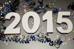 Nouvelle année 2015 sur le noir avec des confettis Image stock
