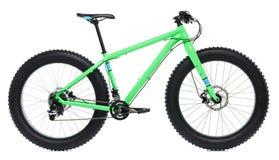 Nouvelle bicyclette bleue avec les pneus épais pour le tour de neige d'isolement sur un wh Image libre de droits