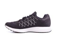Nouvelle chaussure noire d'espadrilles Pris au studio et d'isolement sur le blanc Photos stock