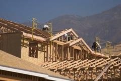 Nouvelle construction de maison et à la maison Photographie stock libre de droits