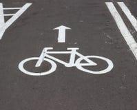 Nouvelle texture d'asphalte avec le symbole de bicyclette Images libres de droits