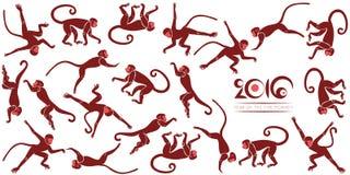 Nouvelles années de carte avec les singes sautants Photos libres de droits