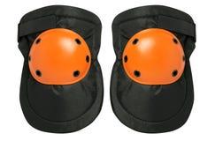 Nouvelles paires de protecteurs de genou d'isolement sur un fond blanc photo stock
