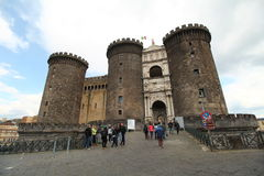 Nouvo Castle exterior, Naples. The new castle in Naples, Italy. Fortress looking building. People approaching the castle Stock Photos