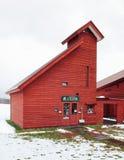 Niseko Milk Kobo Higashiyama Red wood barn in winter snow stock photography