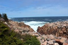 Nova Scotia Cabot Trail East Coastline Canada. Nova Scotia Cabot Trail drive, east coast Canada Scenery. Rocky outcrops on the ocean Stock Images