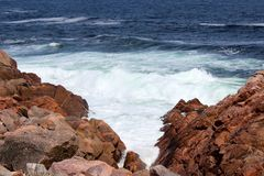 Nova Scotia Cabot Trail Red rocks Ocean Scene Stock Images