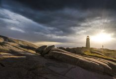 Peggy`s Cove, Nova Scotia, lighthouse at sunset stock images