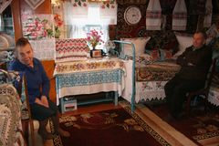 Family. NOVA VOLIA, UKRAINE - 14 November 2008: Unknown senior man and woman in rural parlor Stock Photography