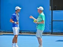 Novak Djokovic практикуя с Boris Becker стоковое изображение