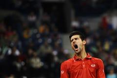 Novak Djokovic reacts during the match Royalty Free Stock Photo