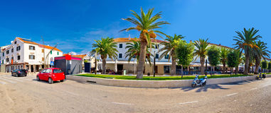 Novalja on Pag island palm waterfront Stock Image