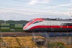 Italian train Frecciarossa running. Novara, Italy -June 25, 2017: High speed train ride in motion. Italian Frecciarossa running to Milan. Editorial Photo Royalty Free Stock Images