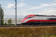 High speed train Frecciarossa runs on rails stock photo