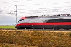 Italian train Frecciarossa running. Novara, Italy -June 25, 2017: High speed train ride in motion. Italian Frecciarossa running to Milan. Editorial Photo Royalty Free Stock Photos