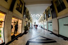 Novara, Italy - October 17, 2016: Popular Shopping Center. Novara, Italy - October 17, 2016: A popular shopping center with boutiques in the antique buildings of stock photography