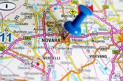 Novara on map. Close up shot of Novara on map with blue push pin Stock Image