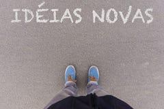 Novas Ideias, πορτογαλικό κείμενο για το φρέσκο κείμενο ιδεών στην άσφαλτο GR Στοκ Φωτογραφία