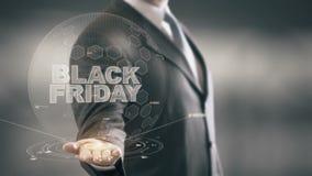 Novas tecnologias disponivéis de Holding do homem de negócios de Black Friday ilustração stock