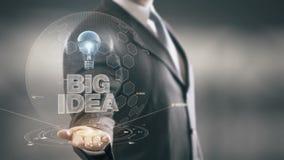 Novas tecnologias disponivéis de Holding do homem de negócios grande da ideia ilustração royalty free