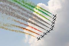 Nove aerei con gli scarichi multicolori Immagine Stock Libera da Diritti
