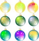 Nove assorted esferas coloridas do Natal no branco Fotografia de Stock Royalty Free
