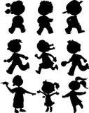 Nove bambini - insieme nero dell'icona Immagine Stock Libera da Diritti