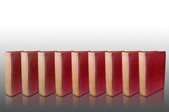 Nove livros vermelhos da tampa no assoalho refletido Imagens de Stock Royalty Free
