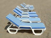 Nove praia-cadeiras fotografia de stock