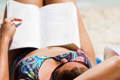 Novel at beach Stock Images