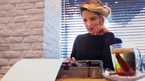 Novelist with typewriter and tea stock video