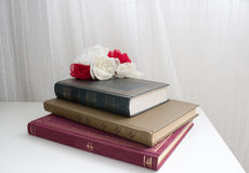 Novels. Books and flowers whites and reds Stock Photography
