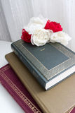 Novels. Books and flowers whites and reds Stock Photos