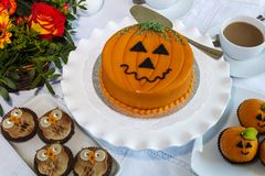 Halloween decorated cakes served on ceramic plate. Stock Photo