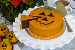 Halloween decorated cakes served on ceramic plate. Royalty Free Stock Photography
