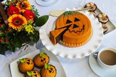 Halloween decorated cakes served on ceramic plate. Stock Photos