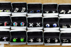 Novelty Cufflinks. A number of sets of novelty cufflinks, in boxes for sale at craft market Royalty Free Stock Images