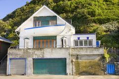 Novelty home in New Zealand. With boat sticking out of front wall near Wellington 2008 - Editorial use only Royalty Free Stock Image