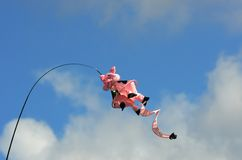 Novelty pig kite flying. Novelty pink pig kite flying Stock Photos