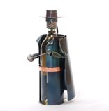Novelty Wine Holder. A novelty metal wine holder crafted to the figure of a bandit Stock Photo