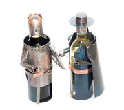 Novelty Wine Holders. Novelty metal wine holders crafted to the figures of a bandit and a knight Stock Photography